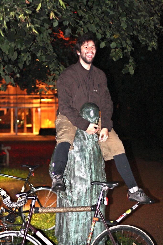 Biker rides statue