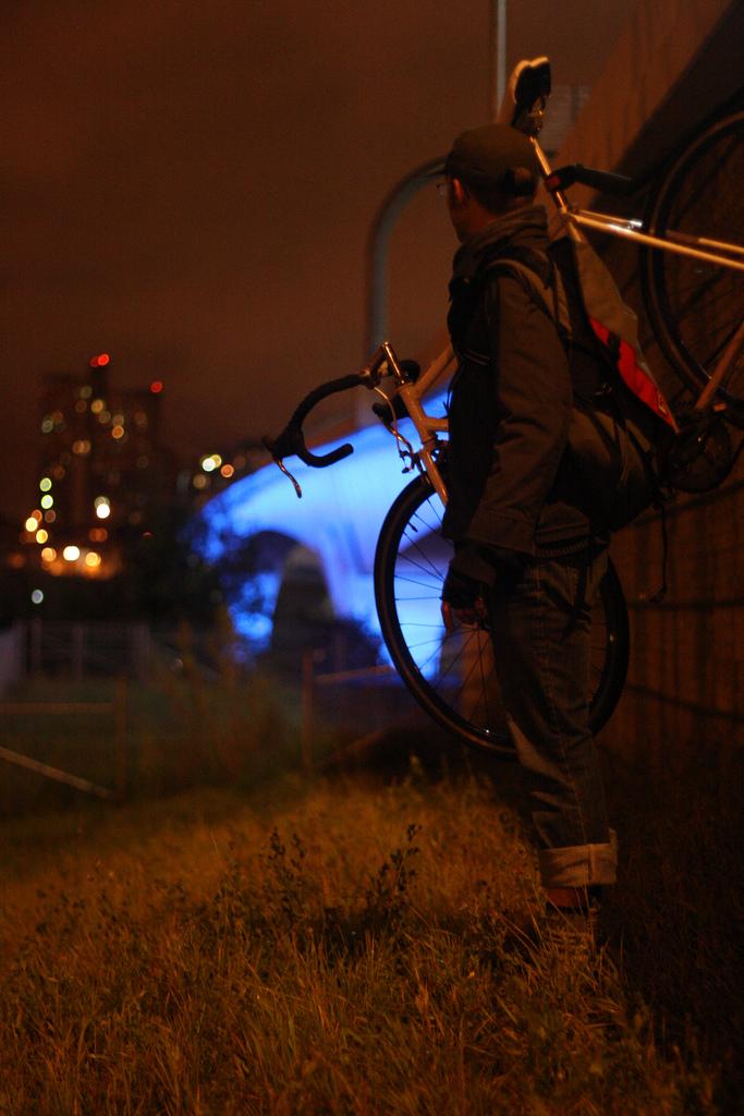Biker w cityscape and blue bridge