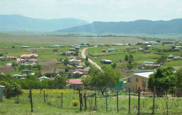 Housing looked better in the rural homelands (bantustans. You can see a few of the traditional round houses with conical roofs.