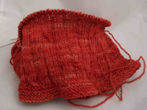 The red cowl was nearly done, but I made up the pattern for it and decided I didn't care for how it fit -- too snug, not enough drape. Soon that cowl will once again be a ball of yarn. I love this yarn. Found the perfect cowl pattern for it yesterday.