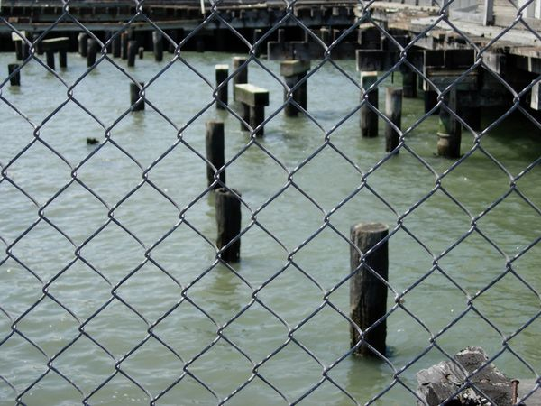 Chain link fence at pier