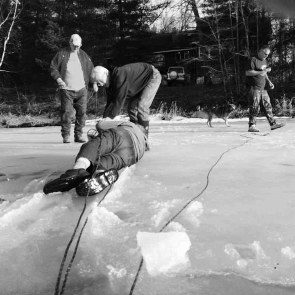 Two more volunteer fireman showed up. With the three of them pulling, they got Smokey onto solid ice.