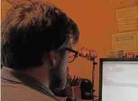 M at computer